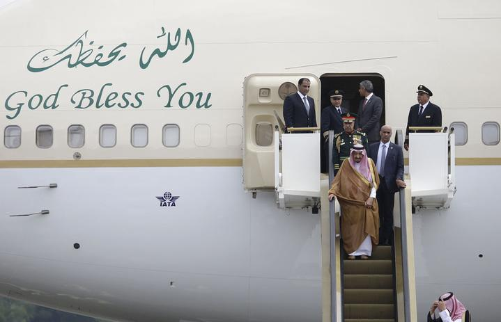 The king made quite an entrance from his gold plane (Credit: AP/REX/Shutterstock)