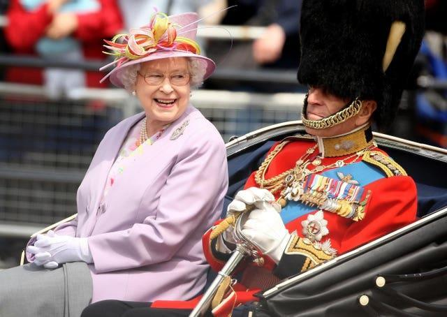 The Queen and the Duke of Edinburgh return to Buckingham Palace by carriage following the Trooping the Colour ceremony at Horse Guards Parade