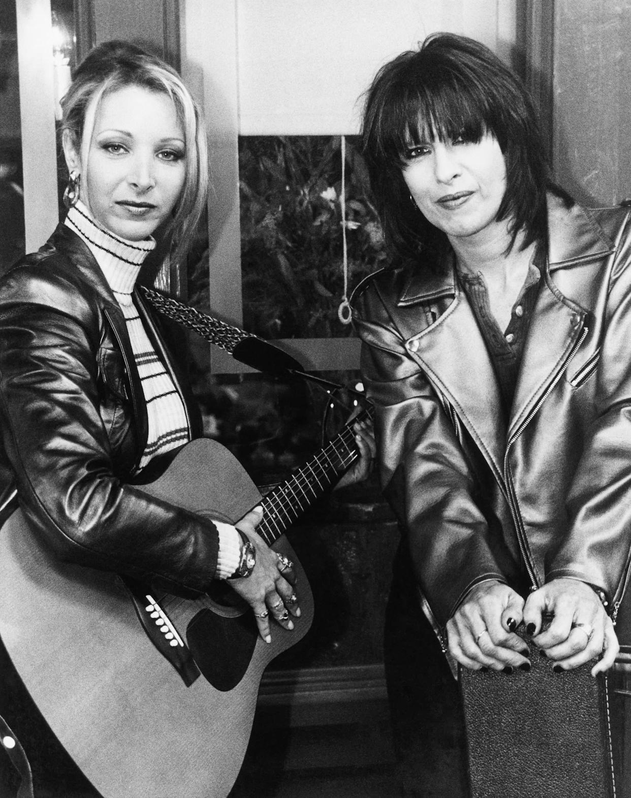 """The actress in a turtleneck on the set of a 1995 episode of """"Friends"""" with Chrissie Hynde."""