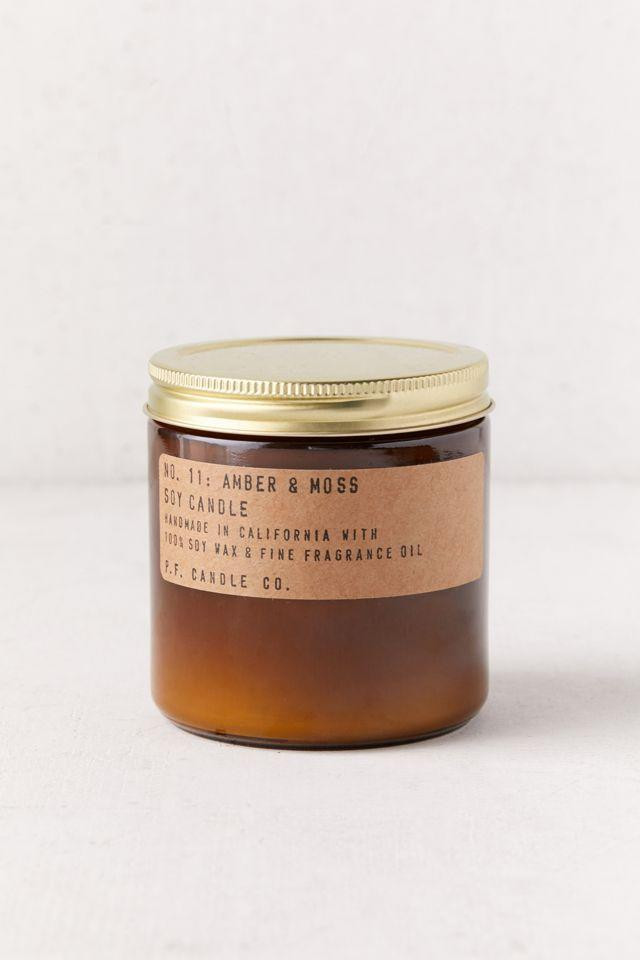 """<h3>P.F. Candle co. Amber Jar 12.5 oz Soy Candle</h3><br>This natural soy wax candle is infused with cozy notes of musk, amber, lavender, sage, and orange that make for the perfect refreshing fall candle. One reviewer claims they'll, """"buy many more,"""" and that they're, """"...super sensitive to scents, but this one didn't give [them] a headache."""" <br><br><em>Shop <strong><a href=""""https://www.urbanoutfitters.com/shop/pf-candle-co-amber-jar-12-oz-soy-candle"""" rel=""""nofollow noopener"""" target=""""_blank"""" data-ylk=""""slk:Urban Outfitters"""" class=""""link rapid-noclick-resp"""">Urban Outfitters</a></strong></em><br><br><strong>P.F. Candle Co.</strong> Amber Jar 12.5 oz Soy Candle, $, available at <a href=""""https://go.skimresources.com/?id=30283X879131&url=https%3A%2F%2Fwww.urbanoutfitters.com%2Fshop%2Fpf-candle-co-amber-jar-12-oz-soy-candle"""" rel=""""nofollow noopener"""" target=""""_blank"""" data-ylk=""""slk:Urban Outfitters"""" class=""""link rapid-noclick-resp"""">Urban Outfitters</a>"""