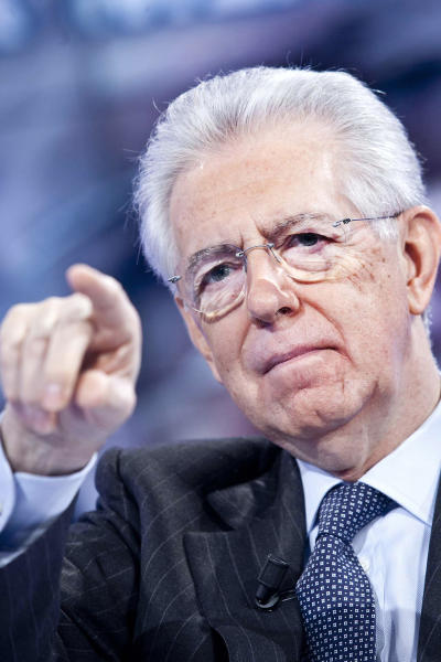 Italian Premier Mario Monti gestures during an interview broadcast on RAI public television Thursday, Jan. 3, 2013. Monti said a second term would demonstrate to Italians that he is not a wicked taxman. Monti, a trained economist, is heading a caretaker government in the run-up to February elections, where he is harnessing a coalition of centrist parties. (AP Photo/Robero Monaldo, Lapresse)