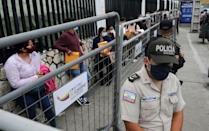 People who will work in polling stations wait for electoral material for Ecuador's upcoming election at the National Electoral Council's headquarters in Guayaquil, Ecuador on February 5, 2021