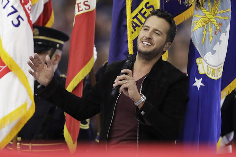 FILE - In this Sunday, Feb. 5, 2017, file photo, Country music singer Luke Bryan sings the national anthem, before the NFL Super Bowl 51 football game between the New England Patriots and the Atlanta Falcons, in Houston. Bryan, Miranda Lambert, Blake Shelton, Florida Georgia Line, Keith Urban, Brad Paisley and more are performing at this year's CMA Music Festival in Nashville, Tenn. The Country Music Association on Friday, March 17, 2017, announced the lineup for concerts at Nissan Stadium on June 8-11, 2017. (AP Photo/Darron Cummings, File)