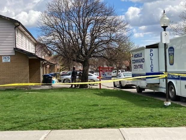 Peel police have set up a mobile command centre outside a home in Mississauga where a person was found dead early Sunday. The person was found with 'obvious signs of trauma.' (Keith Burgess/CBC - image credit)
