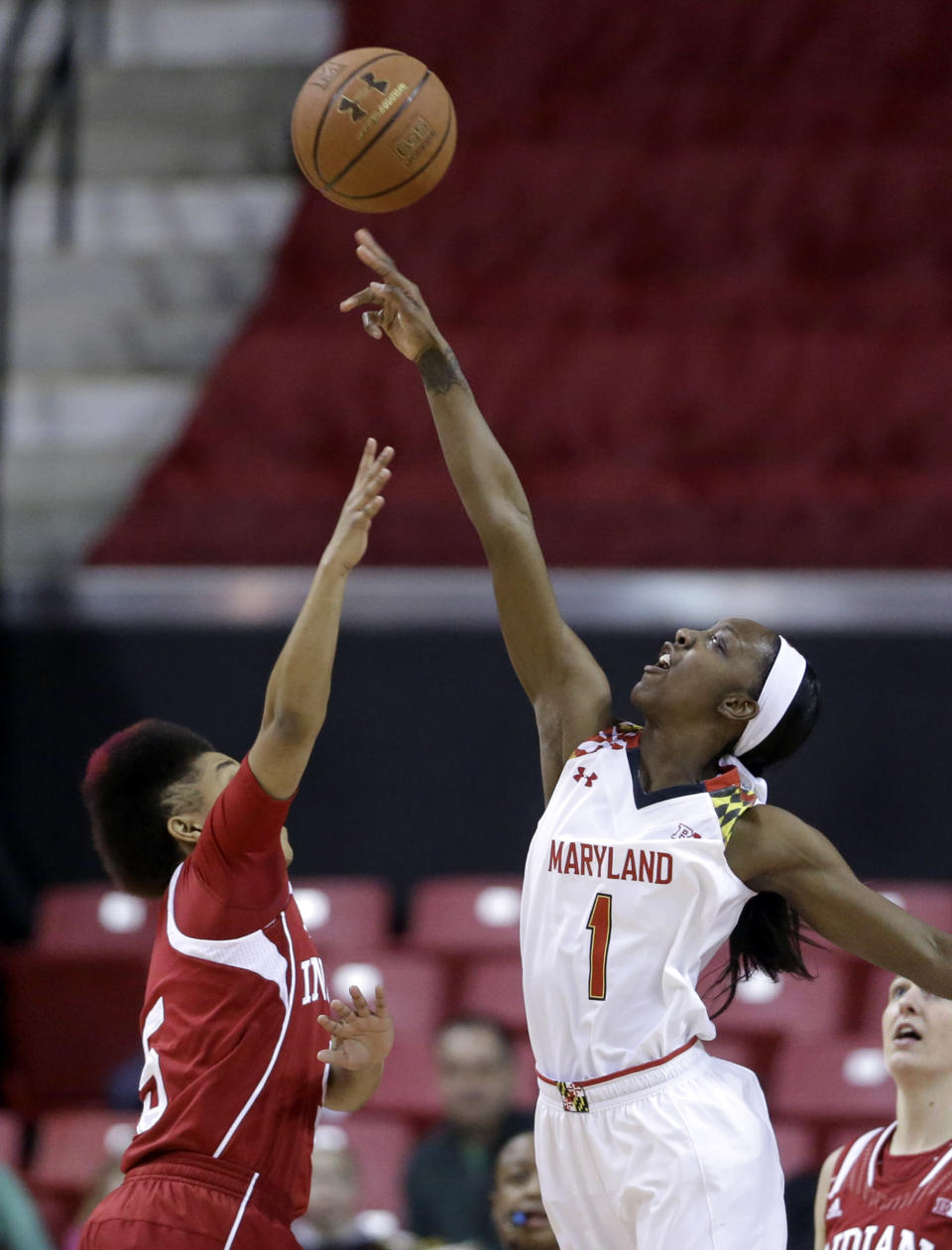 Maryland guard Laurin Mincy, right, reaches for a rebound over Indiana guard Larryn Brooks in the first half of an NCAA college basketball game, Thursday, Feb. 26, 2015, in College Park, Md. (AP Photo/Patrick Semansky)