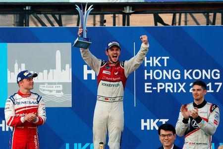 Formula E - FIA Formula E Hong Kong ePrix - Hong Kong - December 3, 2017 ABT Schaeffler Audi Sport's Daniel Abt of Germany celebrates with Mahindra's Felix Rosenqvist of Sweden and Venturi's Edoardo Mortara of Italy fter winning the race. REUTERS/Tyrone Siu