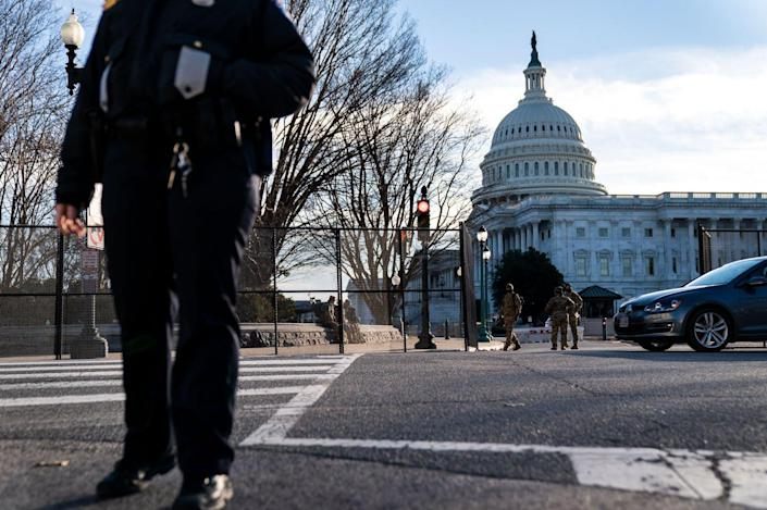 """<span class=""""caption"""">A U.S. Capitol police officer stands at a street corner near the Capitol.</span> <span class=""""attribution""""><a class=""""link rapid-noclick-resp"""" href=""""https://www.gettyimages.com/detail/news-photo/capitol-police-officer-stands-at-a-street-corner-near-the-u-news-photo/1230481038?adppopup=true"""" rel=""""nofollow noopener"""" target=""""_blank"""" data-ylk=""""slk:Kent Nishimura / Los Angeles Times via Getty Images"""">Kent Nishimura / Los Angeles Times via Getty Images</a></span>"""