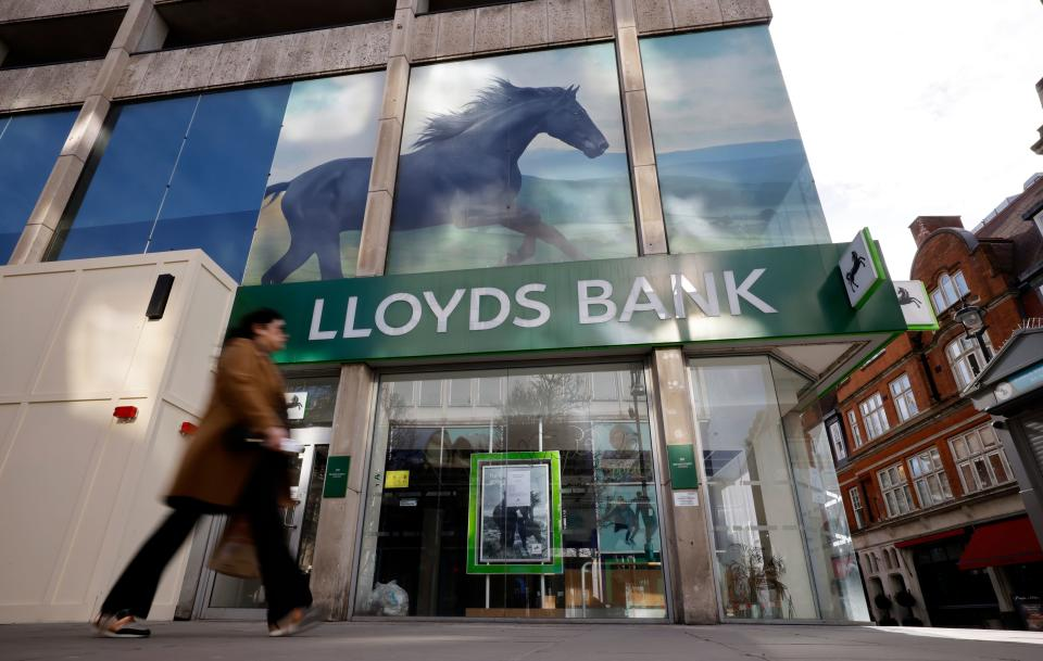 A pedestrian walks past a temporarily closed-down branch of a Lloyds Bank in London on February 24, 2021. - Britain's Lloyds Banking Group on Wednesday reported a slump in 2020 profit due to
