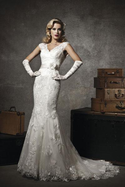 """<div class=""""caption-credit""""> Photo by: Justin Alexander</div><div class=""""caption-title"""">24. Justin Alexander</div>Evoke the glamour of the 1920's in this body-hugging gown by Justin Alexander. <br> <br> Check out more gorgeous styles in our <a rel=""""nofollow noopener"""" href=""""http://www.bridalguide.com/photo-galleries/bridal-gowns/justin-alexander/style-8625"""" target=""""_blank"""" data-ylk=""""slk:Justin Alexander gown gallery"""" class=""""link rapid-noclick-resp"""">Justin Alexander gown gallery</a>!"""