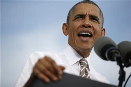 U.S. President Obama delivers remarks on the government funding impasse at a local small business in Maryland
