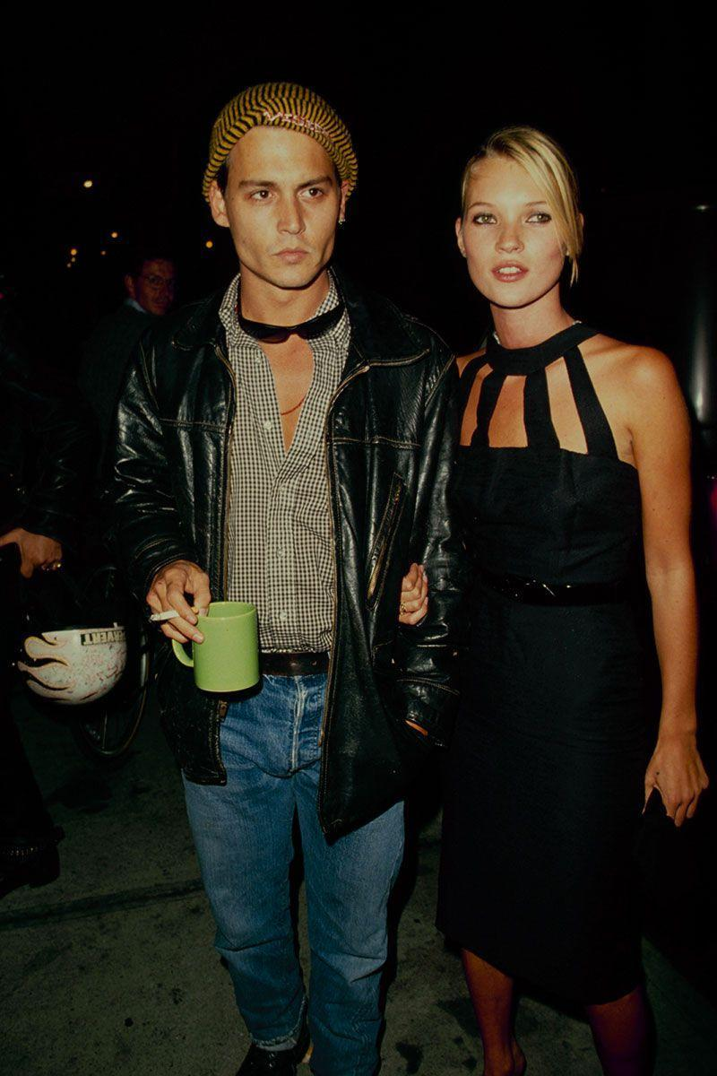 <p>A young model at the time, Kate Moss's black dress with a high neck and cutout details wowed on the red carpet alongside her boyfriend, Johnny Depp. </p>