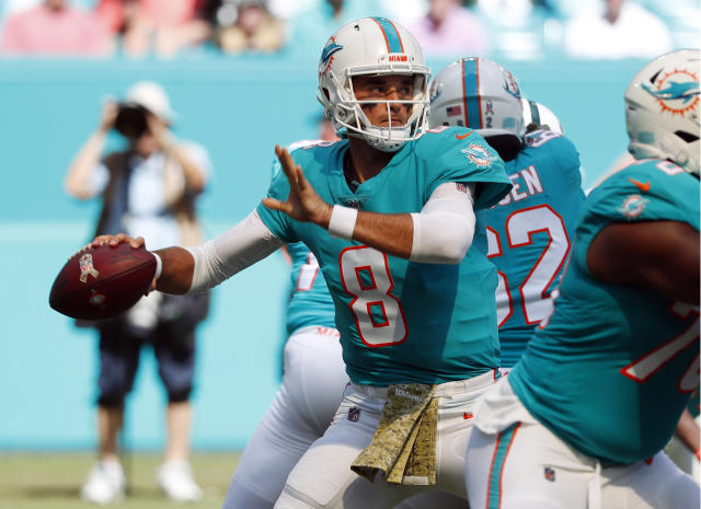 FILE - In this Sunday, Nov. 4, 2018, file photo, Miami Dolphins quarterback Brock Osweiler (8) looks to pass, during the first half of an NFL football game against the New York Jets in Miami Gardens, Fla. The Green Bay Packers are hoping to bounce back from losses to the Rams and Patriots when they host the Dolphins on Sunday. (AP Photo/Wilfredo Lee)