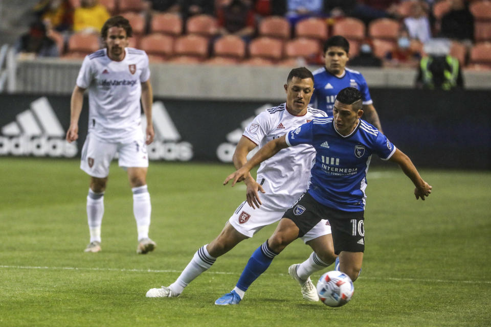 Real Salt Lake defender Donny Toia defends against San Jose Earthquake midfielder Cristian Espinoza (10) during an MLS soccer match Friday, May 7, 2021, in Sandy, Utah. (Annie Barker/The Deseret News via AP)