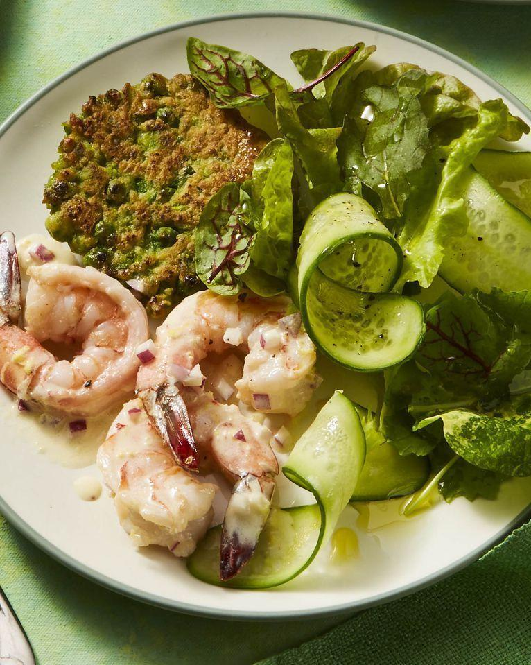 """<p>This light and fresh meal only takes 30 minutes, and it'll give you a a great healthy option for your lunch arsenal. <br></p><p><em><a href=""""https://www.womansday.com/food-recipes/food-drinks/a26730977/pea-fritters-with-shrimp-salad-recipe/"""" rel=""""nofollow noopener"""" target=""""_blank"""" data-ylk=""""slk:Get the Pea Fritters with Shrimp Salad recipe."""" class=""""link rapid-noclick-resp"""">Get the Pea Fritters with Shrimp Salad recipe.</a></em></p>"""