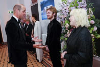 Britain's Prince William, left, speaks with performers Finneas O'Connell and Billie Eilish upon arrival for the World premiere of the new film from the James Bond franchise 'No Time To Die', in London, Tuesday, Sept. 28, 2021. (Chris Jackson/Pool Photo via AP)