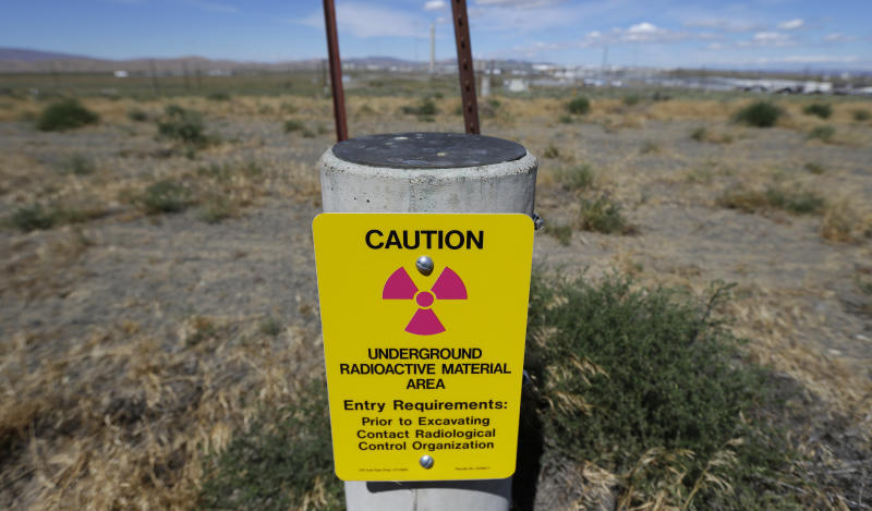 In this photo taken July 11, 2016, a sign warns of radioactive material stored underground on the Hanford Nuclear Reservation near Richland, Wash. The U.S. Energy Department's top official at Washington state's severely contaminated nuclear reservation says future accidental nuclear radiation releases are likely because of aging site infrastructure and inadequate cleanup funding. Hundreds were evacuated May 9, 2017 when the roof of a 1950s rail tunnel storing a lethal mix of waste from plutonium production collapsed. Tests show no radiation was released. (AP Photo/Ted S. Warren)
