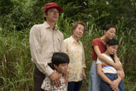 "This image released by A24 shows, from left, Steven Yeun, Alan S. Kim, Yuh-Jung Youn, Yeri Han, and Noel Cho in a scene from ""Minari."" The film won the award for best foreign language motion picture at the Golden Globe Awards on Sunday, Feb. 28, 2021. (Josh Ethan Johnson/A24 via AP)"