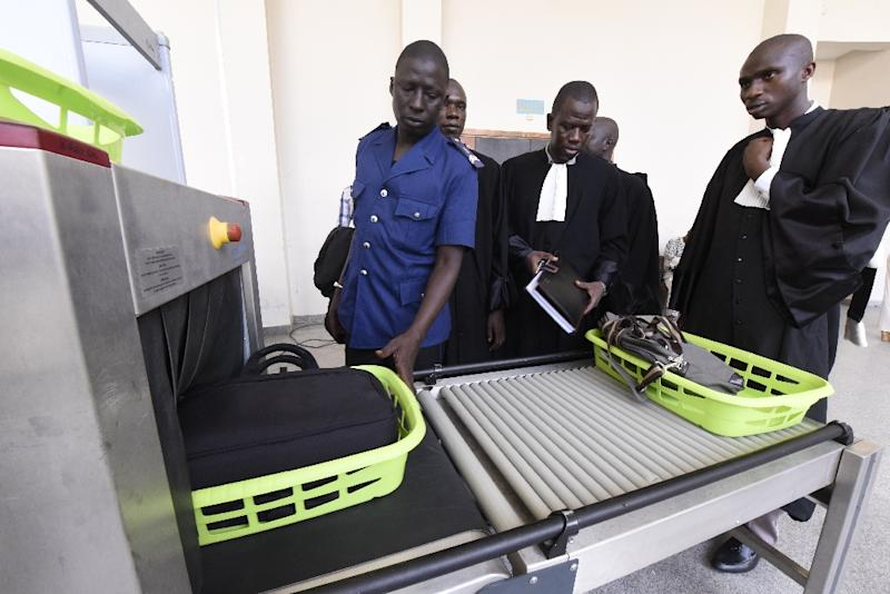 Lawyers pass a security gate at the entrance of the courtroom where the trial of Chad's former dictator Hissene Habre is taking place, in Dakar (AFP Photo/Seyllou)