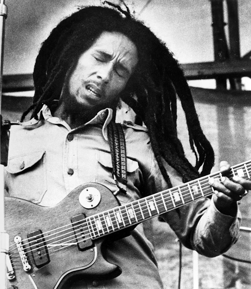 Jamaican reggae singer Bob Marley is shown performing in 1979.  The location is not known.  (AP Photo)
