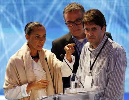 Presidential candidate Marina Silva (L) of Brazilian Socialist Party (PSB) listens to her assessors before their first television debate at the Bandeirantes TV studio in Sao Paulo August 26, 2014. REUTERS/Paulo Whitaker