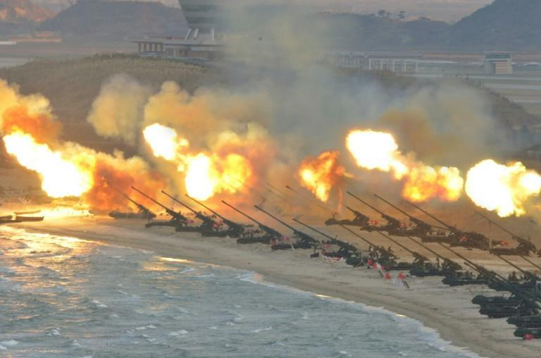 A large-scale intensive striking drill of long-range artillery pieces of the KPA large combined units pictured at an undisclosed location in North Korea in this undated photo