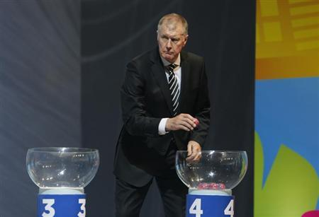 Hurst draws a ball during the draw for the 2014 World Cup in Sao Joao da Mata