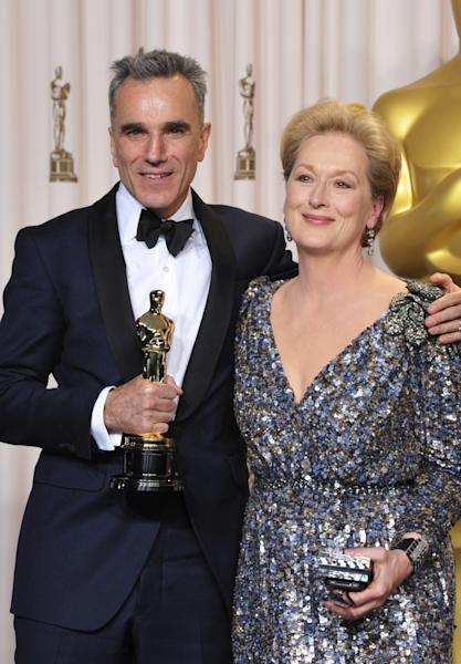 "Daniel Day-Lewis, with his award for best actor in a leading role for ""Lincoln"", left, and presenter Meryl Streep pose during the Oscars at the Dolby Theatre on Sunday Feb. 24, 2013, in Los Angeles. (Photo by John Shearer/Invision/AP)"