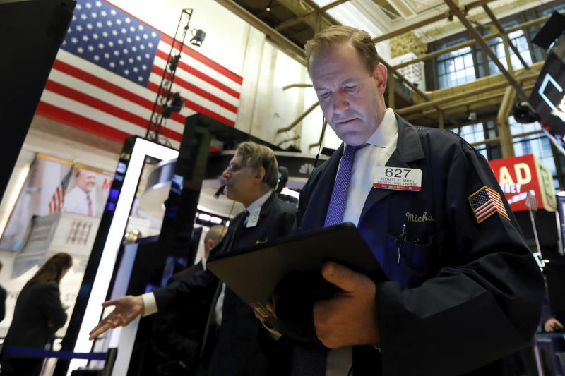 Trader Michael Smyth, right, works on the floor of the New York Stock Exchange, Friday, March 6, 2020. Stocks are opening sharply lower on Wall Street and bond yields are sinking to more record lows as investors fear that economic damage from the spreading coronavirus outbreak will be longer than previously thought. (AP Photo/Richard Drew)