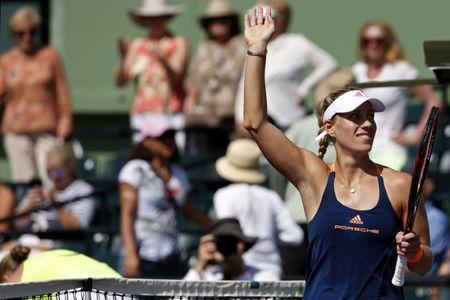 Mar 26, 2017; Miami, FL, USA; Angelique Kerber of Germany waves to the crowd after her match against Shelby Rogers of the United States (not pictured) on day six of the 2017 Miami Open at Crandon Park Tennis Center. Kerber won 6-4, 7-5. Mandatory Credit: Geoff Burke-USA TODAY Sports