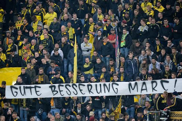 "Borussia Dortmund fans held a banner reading ""Get well Marc"" during their Champions League quarter-final match with Monaco in western Germany, on April 12, 2017 (AFP Photo/Sascha Schuermann )"