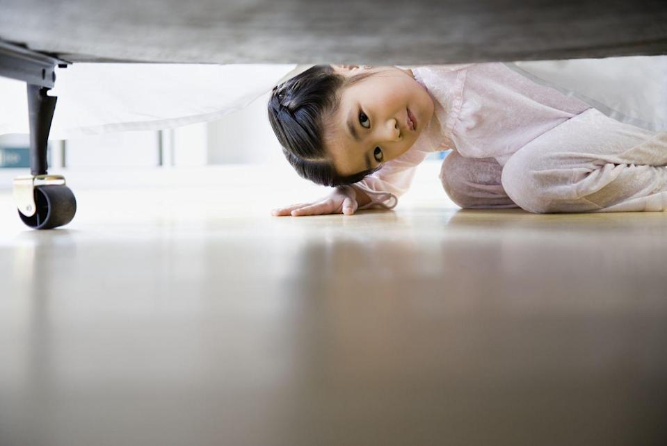 """<p>There are average childhood fears (thinking there is a monster under the bed) and then there are childhood phobias. <a href=""""https://adaa.org/living-with-anxiety/children/childhood-anxiety-disorders"""" rel=""""nofollow noopener"""" target=""""_blank"""" data-ylk=""""slk:Childhood phobias"""" class=""""link rapid-noclick-resp"""">Childhood phobias</a> are more intense and irrational, and they focus on a specific object. For example, your kid might be terrified of a dog or riding a bike for no discernible reason. </p><p>Kids who have these phobias will do anything to avoid situations that may include them, and their anxious behavior can come out in tantrums, crying, clinging, and stomach aches. <br></p>"""