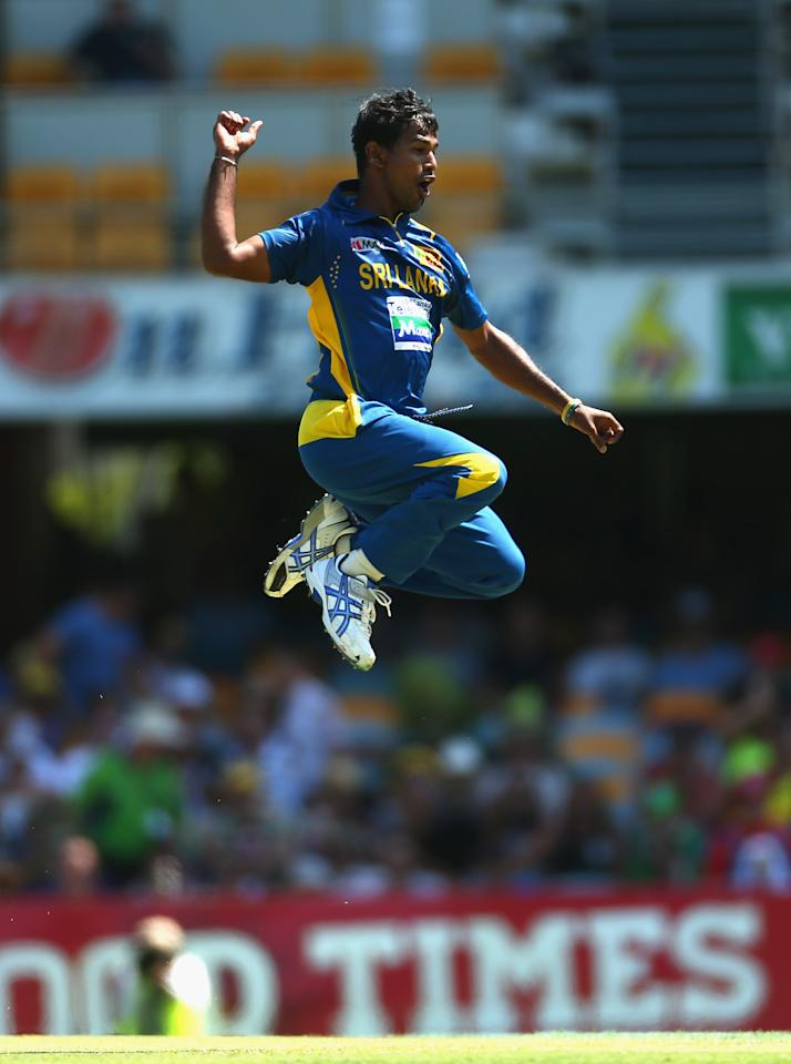 BRISBANE, AUSTRALIA - JANUARY 18:  Nuwan Kulasekara of Sri Lanka celebrates taking the wicket of Michel Clarke of Australia during game three of the Commonwealth Bank One Day International Series between Australia and Sri Lanka at The Gabba on January 18, 2013 in Brisbane, Australia.  (Photo by Robert Cianflone/Getty Images)