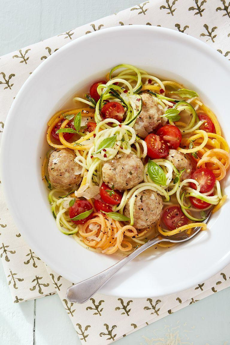 """<p>Go low-carb with this healthy recipe that calls for sprialized """"zoodles.""""</p><p><strong><a href=""""https://www.countryliving.com/food-drinks/a16570861/chicken-meatball-and-vegetable-noodle-soup-recipe/"""" rel=""""nofollow noopener"""" target=""""_blank"""" data-ylk=""""slk:Get the recipe."""" class=""""link rapid-noclick-resp"""">Get the recipe. </a></strong></p>"""