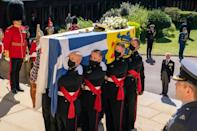 The coffin was draped in his standard and topped by a wreath of white roses and lilies from the Queen as well as his naval cap and ceremonial sword