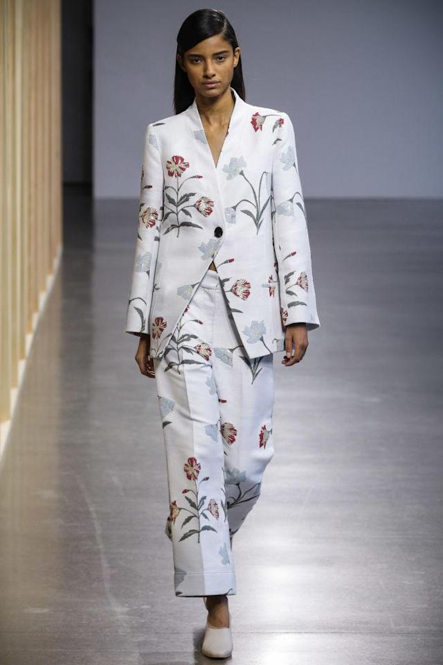 <p>Model wears a floral pantsuit at the fall 2018 Claudia Li show. (Photo: Getty Images) </p>