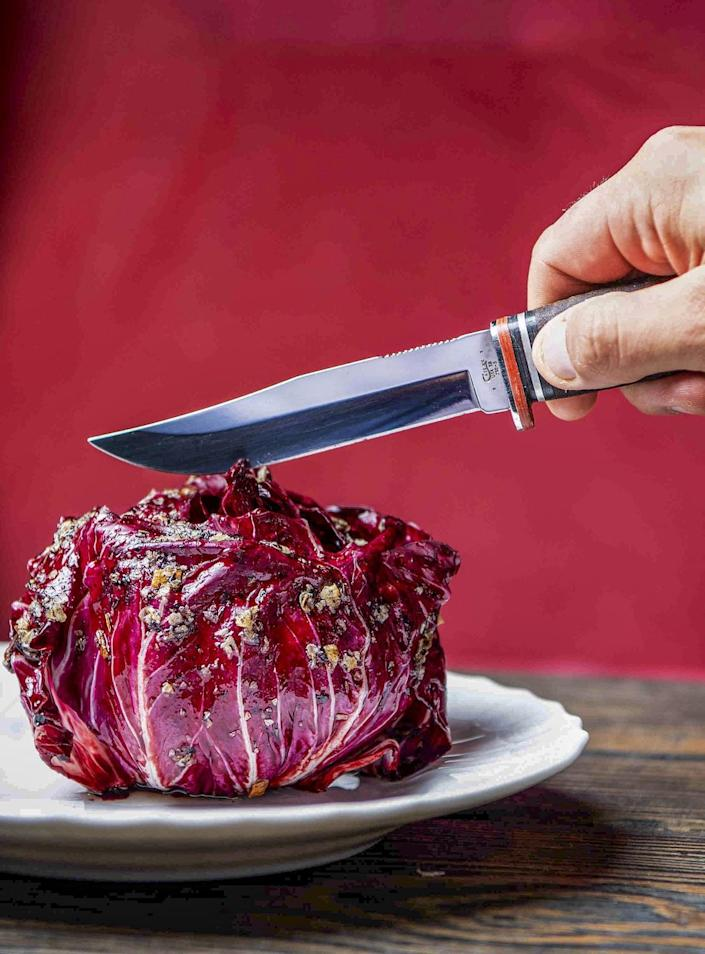 A knife is about to cut into Radicchio with Radicchio XO.