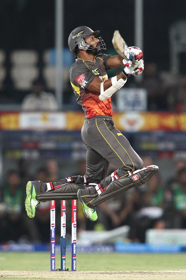 Shikhar Dhawan of Sunrisers Hyderabad upper cuts a delivery for six during match 72 of the Pepsi Indian Premier League between The Sunrisers Hyderabad and The Kolkata Knight Riders held at the Rajiv Gandhi International Stadium, Hyderabad on the 19th May 2013. (BCCI)