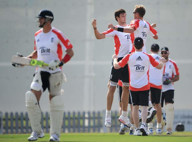 DUBAI, UNITED ARAB EMIRATES - JANUARY 06:  Steven Finn and Stuart Broad of England celebrate the wicket Kevin Pietersen during a nets session at The ICC Global Academy on January 6, 2012 in Dubai, United Arab Emirates.  (Photo by Gareth Copley/Getty Images)