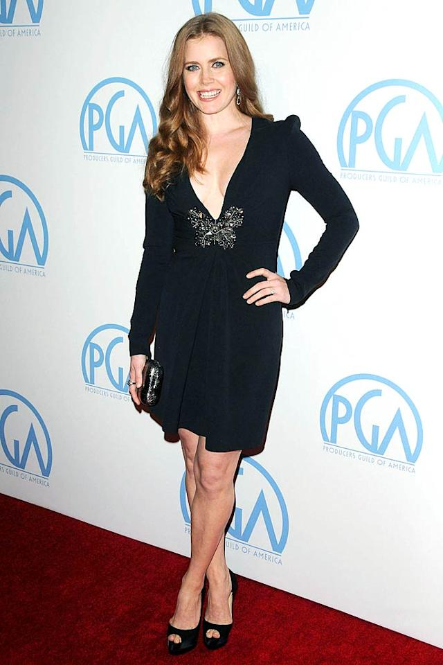"""Amy Adams also knows how to work a LBD. The Oscar-nominated """"Fighter"""" star put her best foot forward at the 22nd Annual Producers Guild Awards in a sexy Andrew Gn dress. The butterfly detailing at the waist definitely added some drama, as did her Christian Louboutin peep-toes and Kotur clutch. Tina Kaawaloa/<a href=""""http://www.infdaily.com"""" target=""""new"""">INFDaily.com</a> - January 22, 2011"""