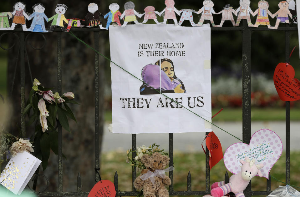 A poster featuring a drawing of Prime Minister Jacinda Ardern hangs on a wall at the Botanical Gardens in Christchurch. Source: AP