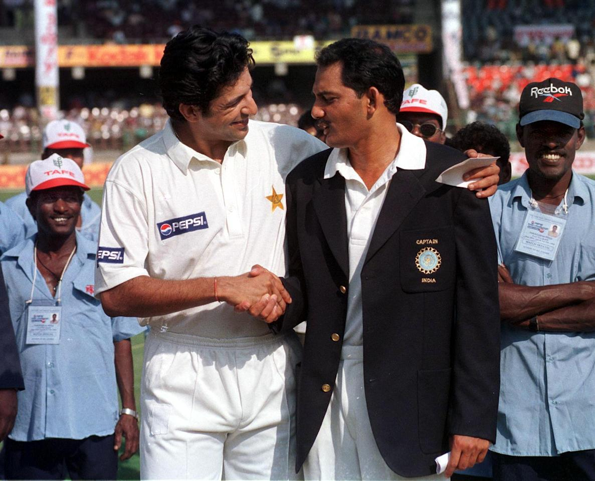 MADRAS, INDIA:  Pakistani cricket team captain Wasim Akram (L) and his Indian counterpart Mohammad Azharuddin (R) shake hands after the toss on the cricket pitch at Chidambaram stadium in Madras 28 January, on the first day of the first Test between arch rivals India and Pakistan on Indian soil in 12 years.   Pakistan made a disappointing start, grabbing 168 for 6 at tea break.    AFP PHOTO (Photo credit should read JOHN MACDOUGALL/AFP/Getty Images)