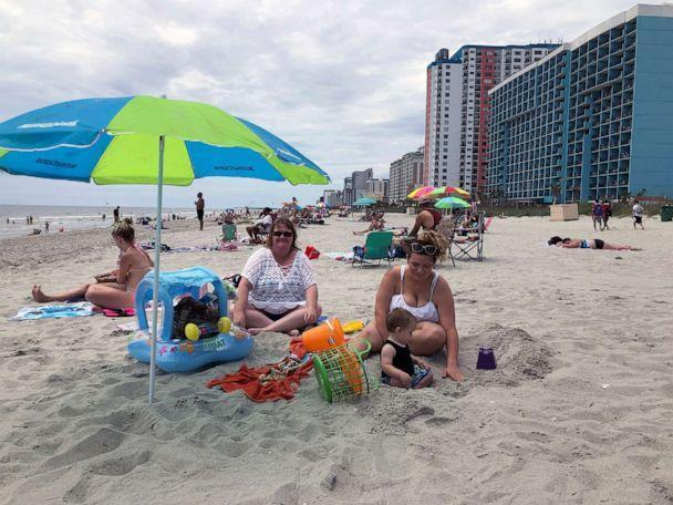 PHOTO: A family enjoys a day at the beach in Myrtle Beach, South Carolina, on June 18, 2020. (Jeffrey Collins/AP)