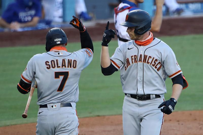 LOS ANGELES, CALIFORNIA - AUGUST 08: Austin Slater #13 of the San Francisco Giants celebrates his home run against the Los Angeles Dodgers with Donovan Solano #7 during the third inning at Dodger Stadium on August 08, 2020 in Los Angeles, California. (Photo by Katelyn Mulcahy/Getty Images)