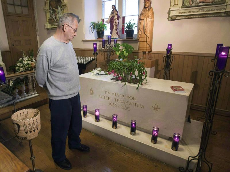 In this December 19, 2011, photo, deacon Ron Boyer looks at the tomb of Kateri Tekakwitha at St. Francis Xavier Church, in Kahnawake, Que. The woman who is credited with life-saving miracles is set to become North America's first aboriginal saint. Kateri Tekakwitha is to be canonized by the Pope at a Vatican mass on Sunday, Oct. 21, 2012. (AP Photo/The Canadian Press, Ryan Remiorz)