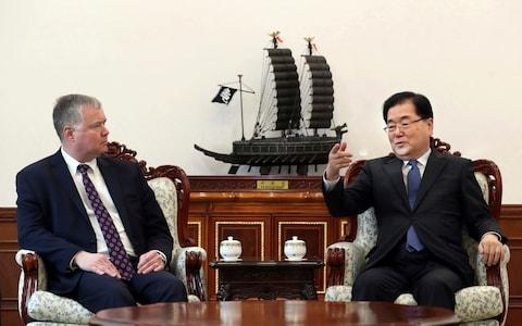 U.S. Special Representative for North Korea Stephen Biegun, left, talks with South Korean National Security Director Chung Eui-yong during a meeting at the Presidential Blue House in Seoul, South Korea - Credit: AP