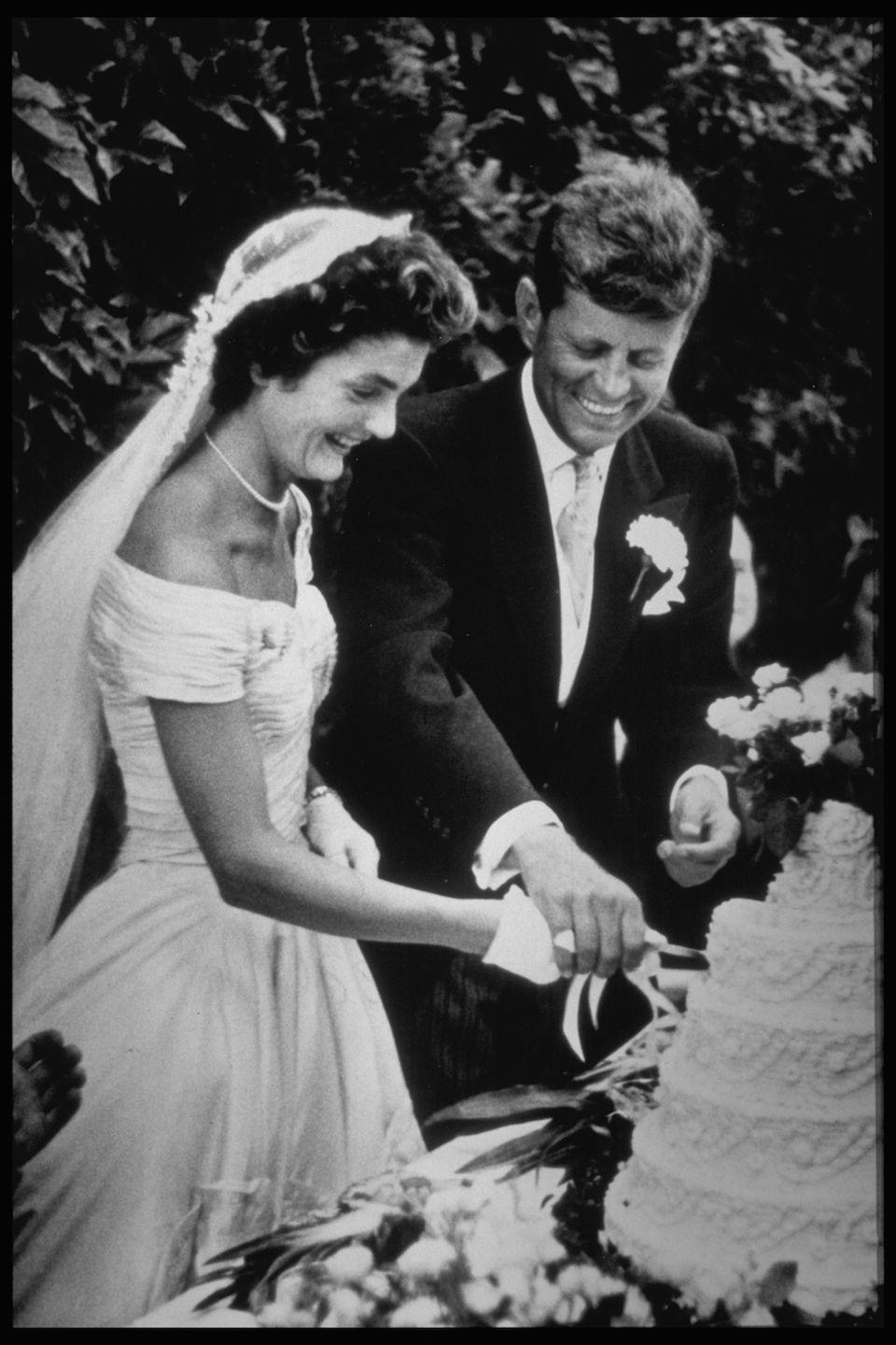 "<p>On September 12, <a href=""https://www.jfklibrary.org/Research/Research-Aids/Ready-Reference/JKO-Fast-Facts/Wedding-Details.aspx"" rel=""nofollow noopener"" target=""_blank"" data-ylk=""slk:Jacqueline Bouvier"" class=""link rapid-noclick-resp"">Jacqueline Bouvier</a> weds then-Senator John Fitzgerald Kennedy in Newport, Rhode Island. Their reception at Hammersmith Farm would host more than 1,200 guests. </p><p><em>RELATED: <a href=""https://www.goodhousekeeping.com/life/entertainment/a33611/jackie-kennedy-onassis-facts/"" rel=""nofollow noopener"" target=""_blank"" data-ylk=""slk:12 things you didn't know about Jackie O"" class=""link rapid-noclick-resp"">12 things you didn't know about Jackie O</a></em></p>"