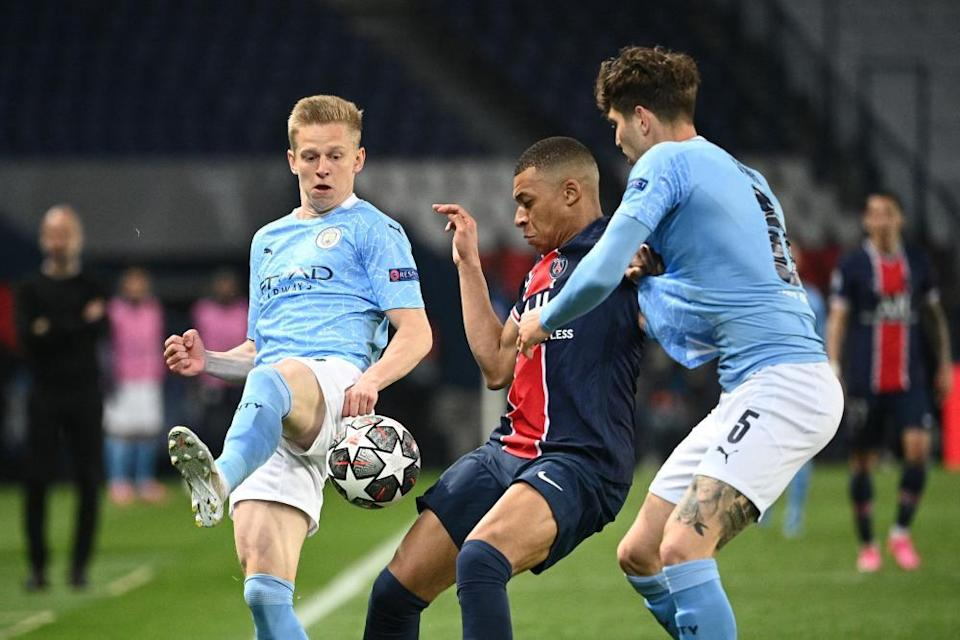 Kylian Mbappé is hustled off the ball by John Stones and Oleksandr Zinchenko. City restricted PSG to one set-piece goal in their two-leg tie.
