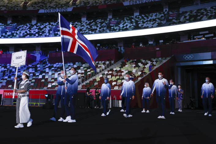 <p>TOKYO, JAPAN - JULY 23: Flag bearers Snaefridur Sol Jorunnardottir and Anton Mckee of Team Iceland lead their team during the Opening Ceremony of the Tokyo 2020 Olympic Games at Olympic Stadium on July 23, 2021 in Tokyo, Japan. (Photo by Jamie Squire/Getty Images)</p>