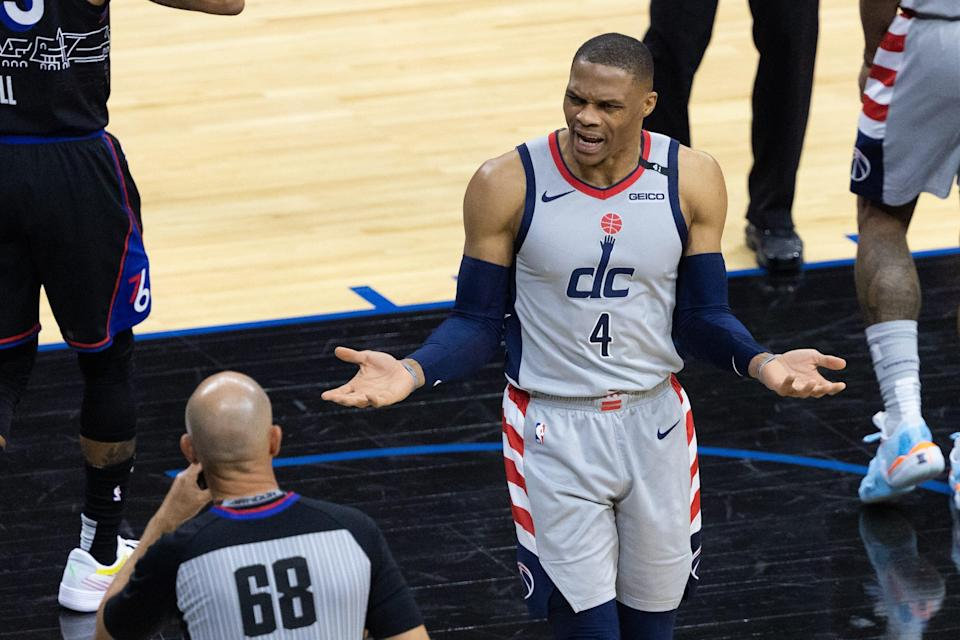 Wizards guard Russell Westbrook argues a call with referee in Philadelphia.