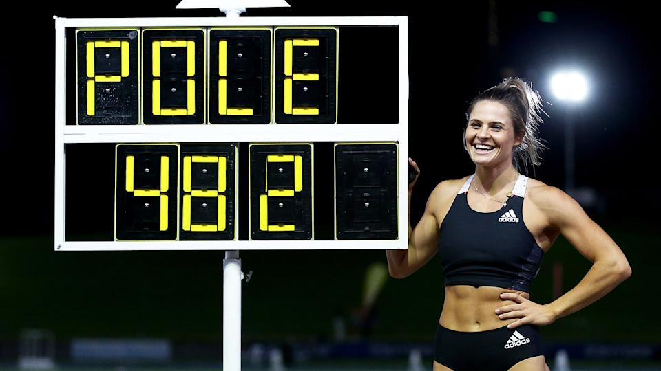 Nina Kennedy, pictured here posing next to her Australian Pole Vault record of 4.82m.